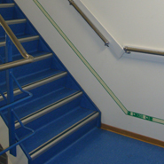 An escape guidance system installed in a staircase of a ship.