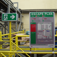 Escape route signage in line with the escape plan in industrial environments.
