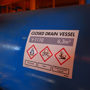 A tank marking adapted to the offshore industry with GHS hazard symbols.