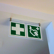 Signs to identify the position of present first aid or rescue equipment.