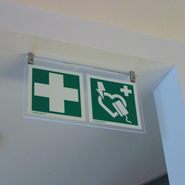 Elegant version of rescue equipment signage in an office environment.