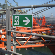 A railing mounted escape sign for use in harsh environments