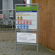 A gate sign with general and safety information positioned at an entrance.