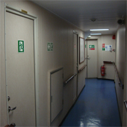 Safety Signs according to IMO in living quarters of a ship.